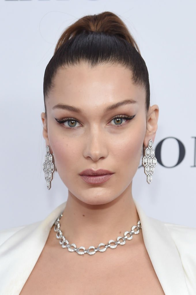 Image Credit: Getty Images / Supermodel Bella Hadid poses for a picture on the red carpet.