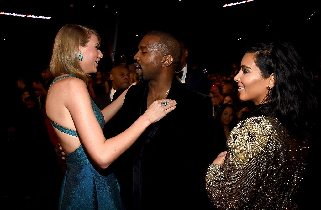 Image Credit: Getty Images / Taylor Swift, Kanye West and Kim Kardashian attend The 57th Annual GRAMMY Awards on February 8, 2015 in Los Angeles, California.