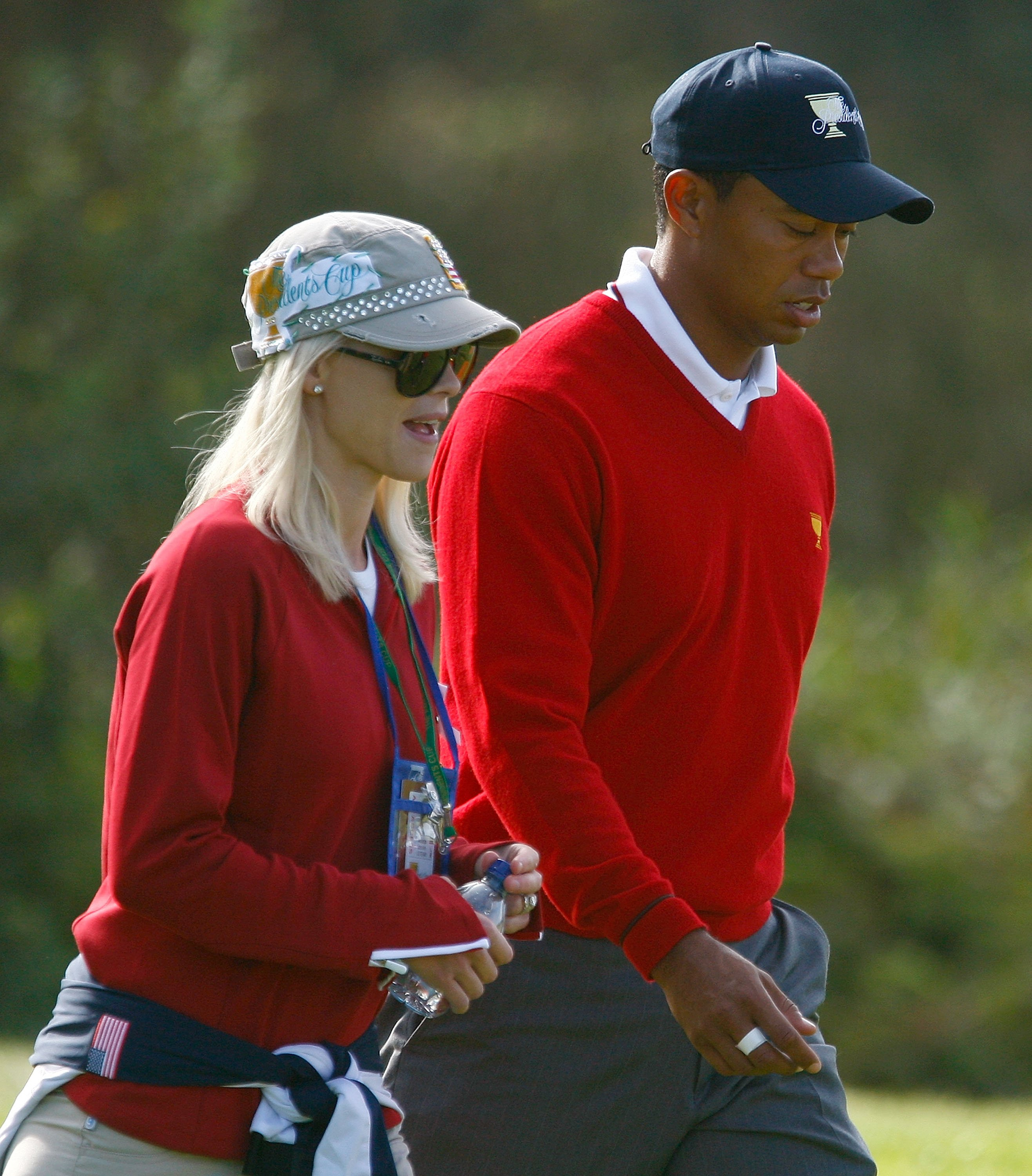 Image Credits: Getty Images / Scott Halleran | Tiger Woods of the USA Team walks with his wife Elin during the Day One Foursome Matches of The Presidents Cup at Harding Park Golf Course on October 8, 2009 in San Francisco, California.