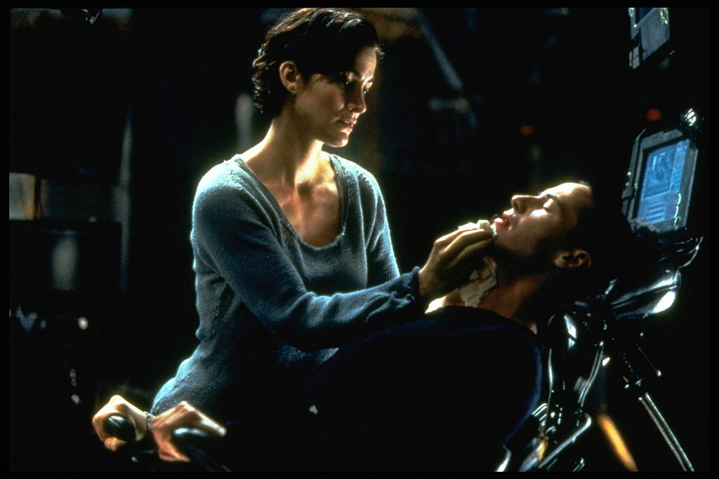 Image Credits: Getty Images / Ronald Siemoneit / Sygma | Carrie-Anne Moss and Keanu Reeves in The Matrix.