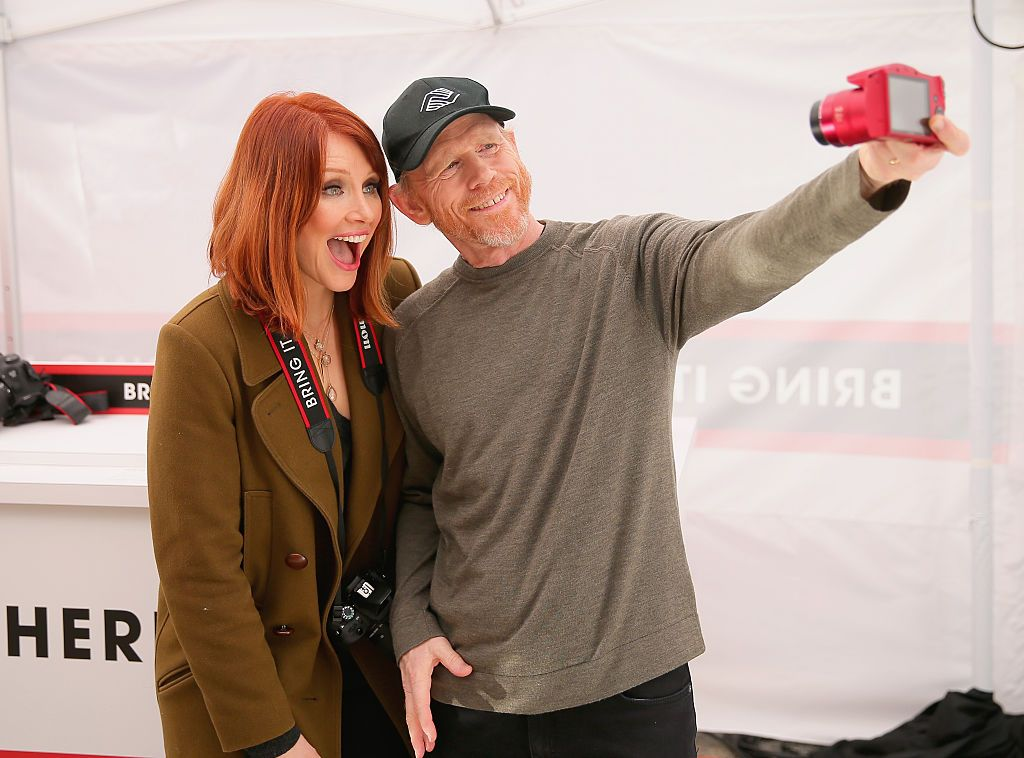 Actress Bryce Dallas Howard, with filmmaker Ron Howard, hosts the Canon Let It Snow Globe spectacle / Getty Images