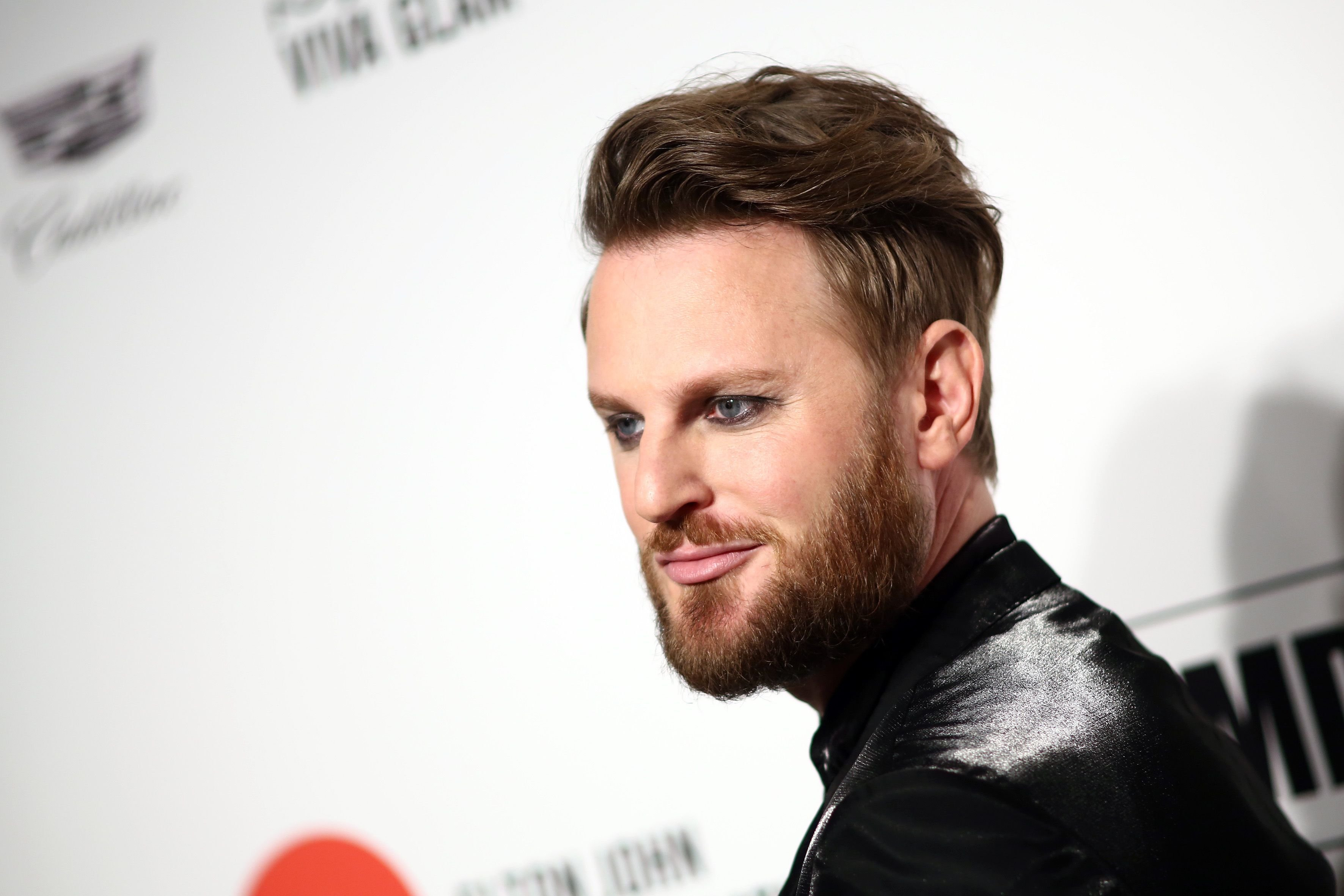 Bobby Berk walks the red carpet at the Elton John AIDS Foundation Academy Awards Viewing Party / Getty Images