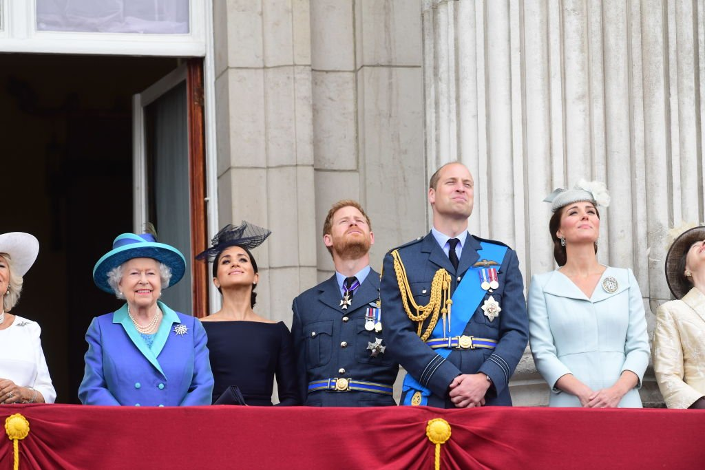 Image Credits: Getty Images | The Queen stands with members of the royal family on the famous balcony.