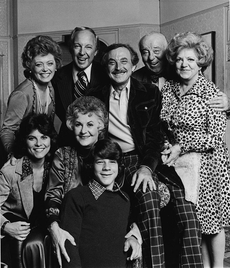 Image Credits: Getty Images / CBS Photo Archive | Promotional portrait of the cast of the television series, 'Maude,' 1976. Top (L-R): Rue McLanahan, Conrad Bain, Bill Macy, J. Pat O'Malley, Hermione Baddeley. Front (L-R): Adrienne Barbeau, Beatrice Arthur and Brian Morrison.