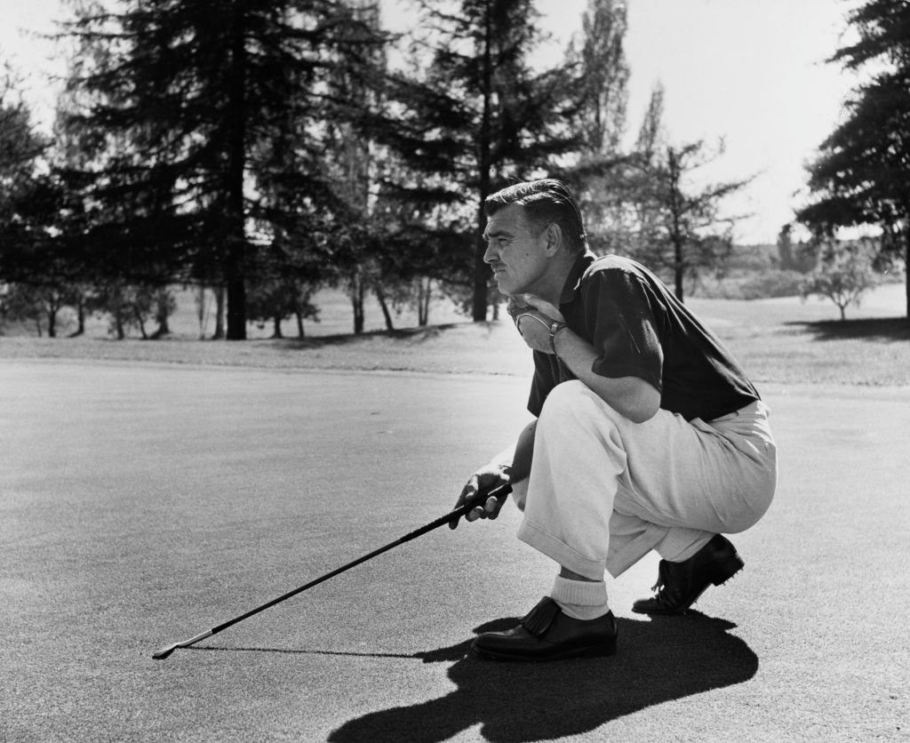 Image Credit: Getty Images / Actor Clark Gable also called The King of Hollywood poses for a picture while playing golf.