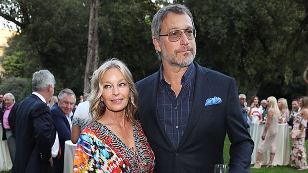 Image Credits: Shutterstock / Bo Derek and John Corbett pose together for a photo.