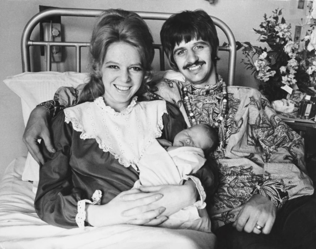 Image Credits: Getty Images / Keystone / Hulton Archive | Beatles drummer Ringo Starr with his wife Maureen and their new baby boy Jason at Queen Charlotte's Hospital, London, 21st August 1967.