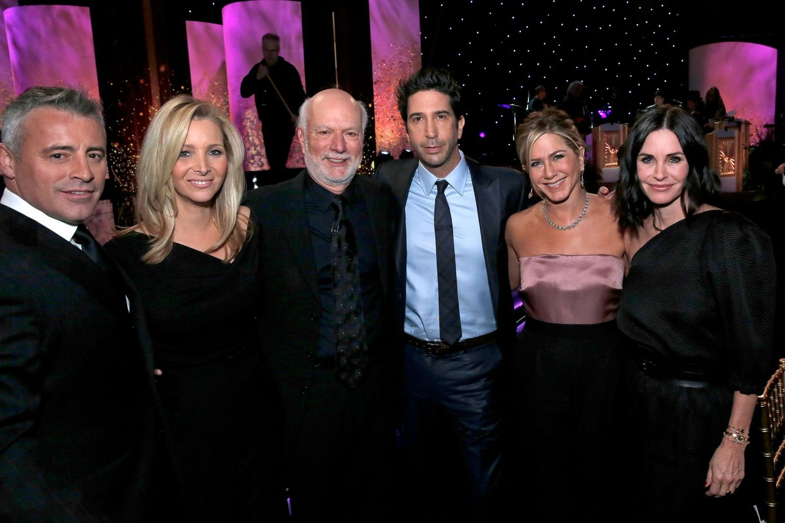 MUST SEE TV: AN ALL-STAR TRIBUTE TO JAMES BURROWS -- Pictured: (l-r) Matt LeBlanc, Lisa Kudrow, James Burrows, David Schwimmer, Jennifer Aniston, Courteney Cox -- (Photo by: Chris Haston/NBCU Photo Bank/NBCUniversal via Getty Images via Getty Images)