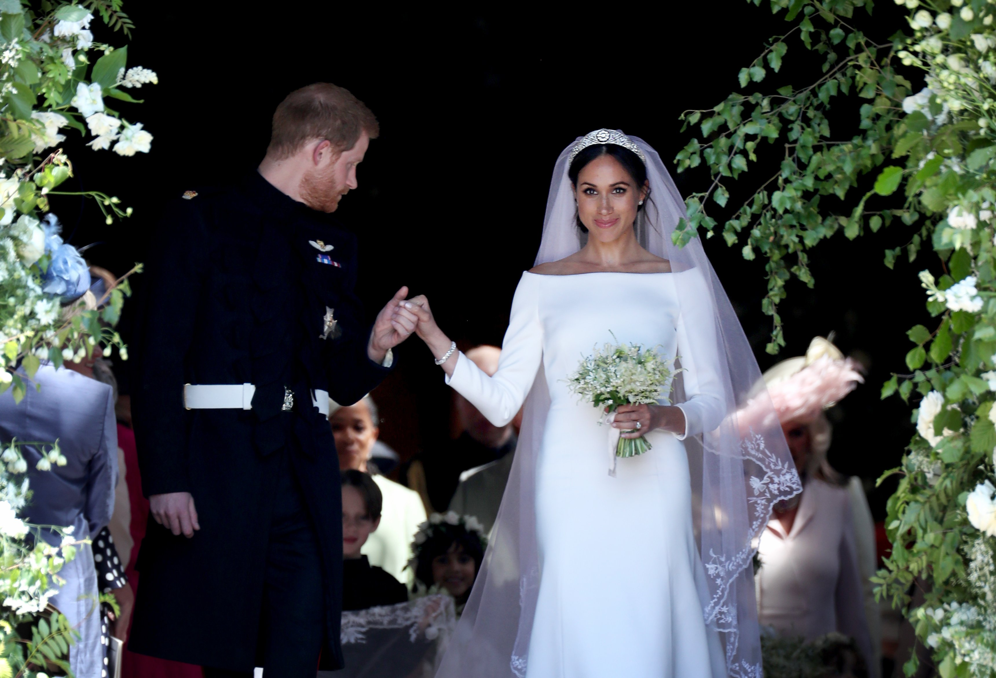 Image Source: Getty Images/Prince Harry and bride to be Meghan Markle
