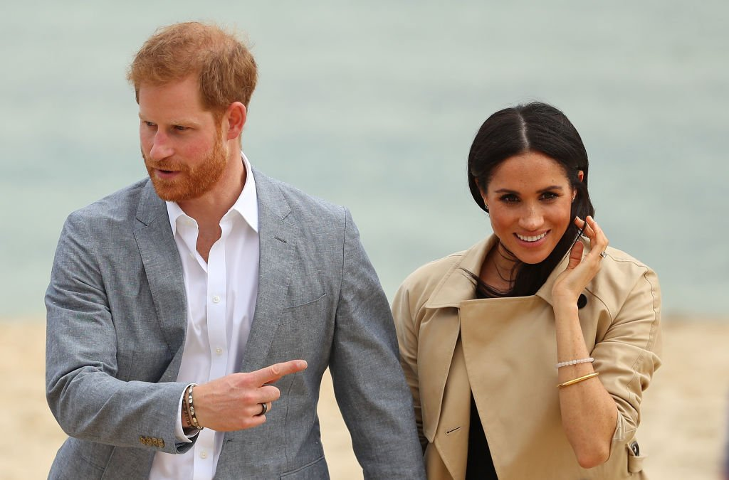 Image Credits: Getty Images / Scott Barbour   Prince Harry, Duke of Sussex wearing a Oura Health fitness tracker ring and Meghan, Duchess of Sussex walk at South Melbourne Beach on October 18, 2018 in Melbourne, Australia.