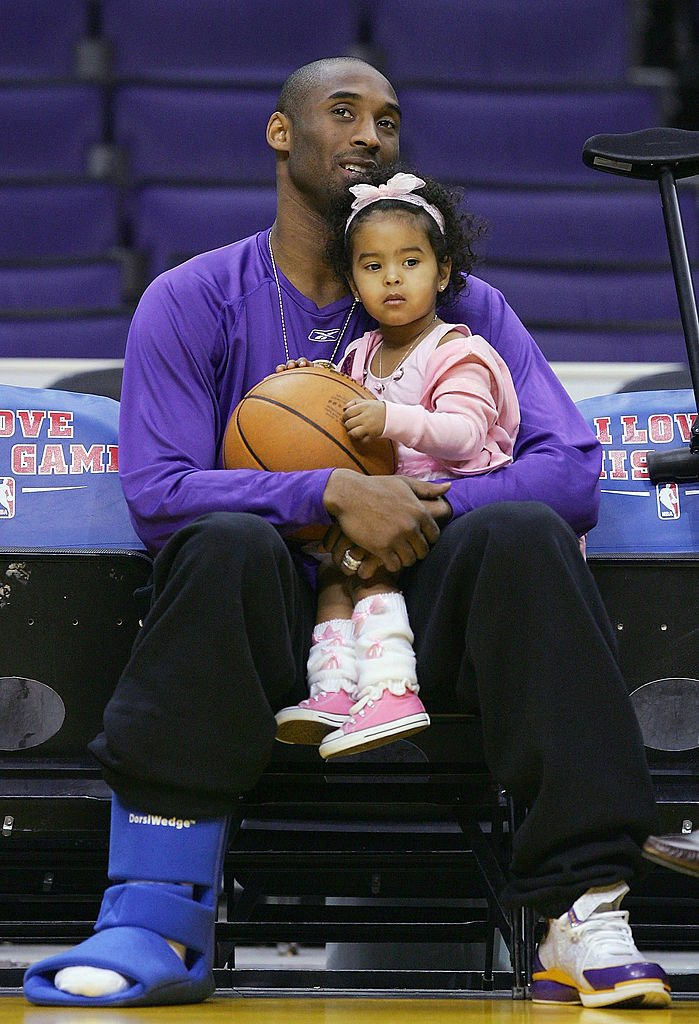 Image Source: Getty Images/Lisa Blumenfeld/Kobe Bryant #8 of the Los Angeles Lakers sits with his daughter, Natalia