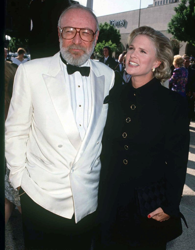 Image Credits: Getty Images / Kypros | Barney Rosenzweig with wife Sharon Gless