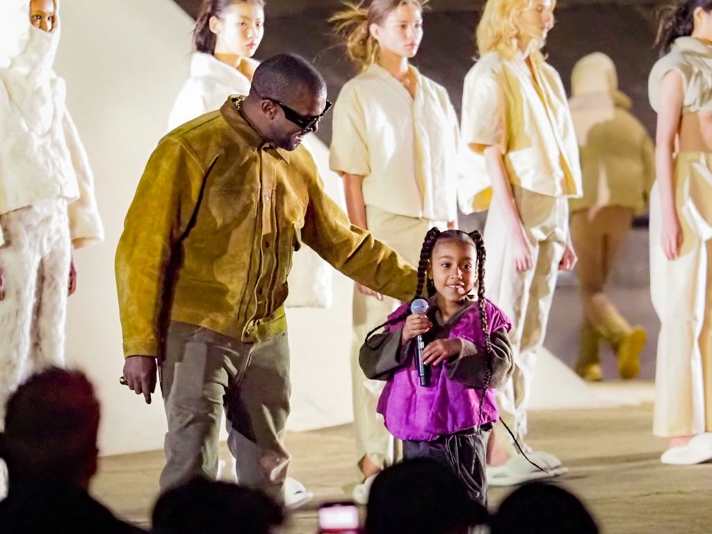 "Image Credit: Getty Images / Kanye West and daughter North West attends the ""Yeezy Season 8"" show as part of the Paris Fashion Week Womenswear Fall/Winter 2020/2021 on March 02, 2020 in Paris, France."