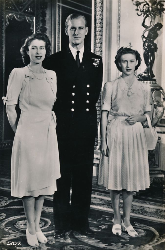 Princess Elizabeth and Princess Margaret with Lieut. Philip Mountbatten', 9 July 1947. | Source: Getty Images
