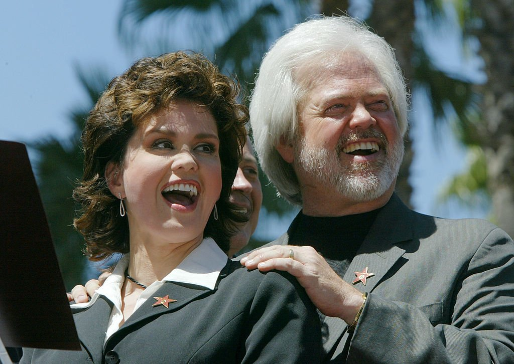 Image Credit: Getty Images / Marie and Merrill Osmond attend a ceremony honoring The Osmond family with a star on the Hollywood Walk of Fame August 7, 2003 in Hollywood.