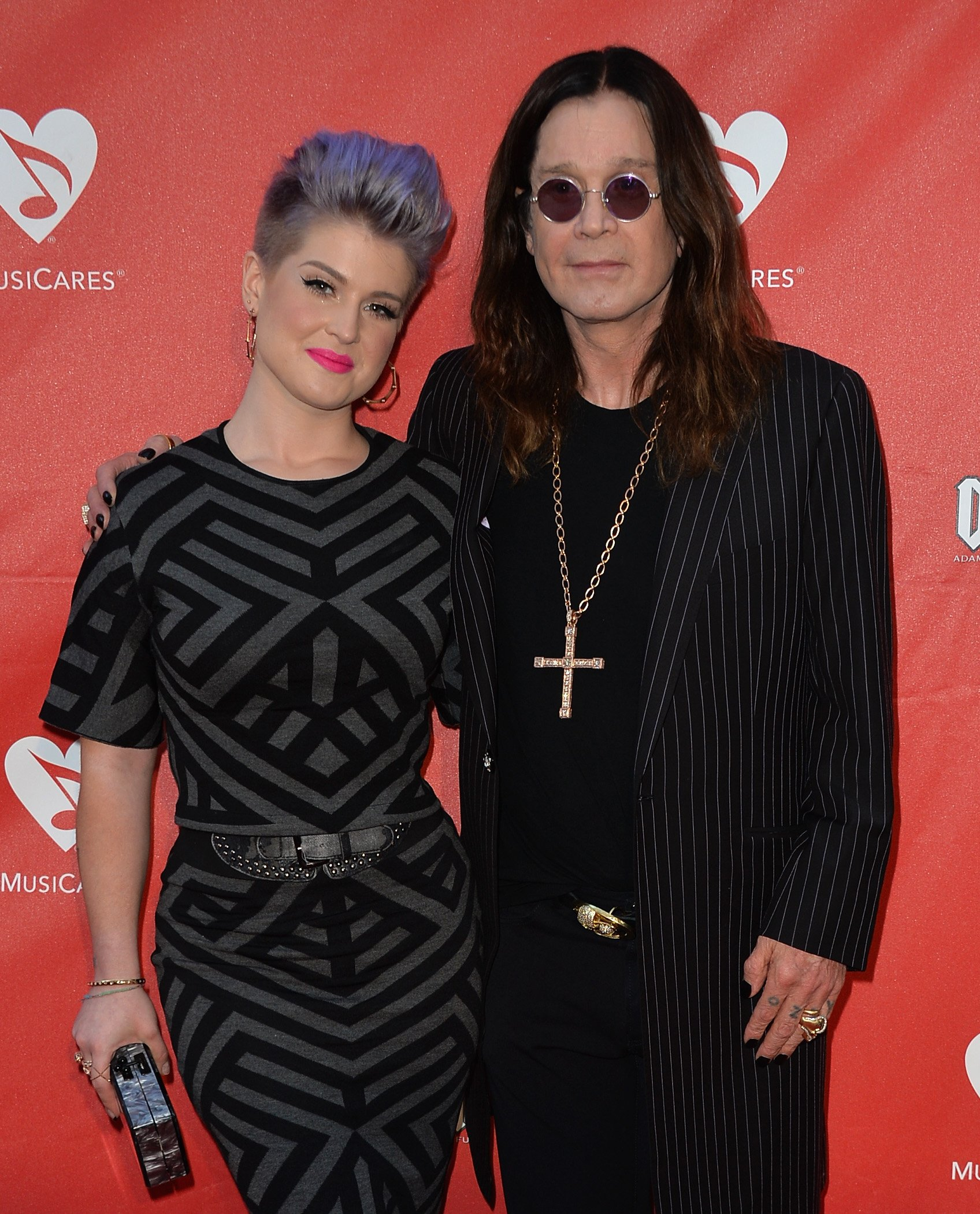 Image Credit: Getty Images/Frazer Harrison | Kelly and Ozzy at the 2014 10th Annual MusiCares MAP Fund Benefit Concert