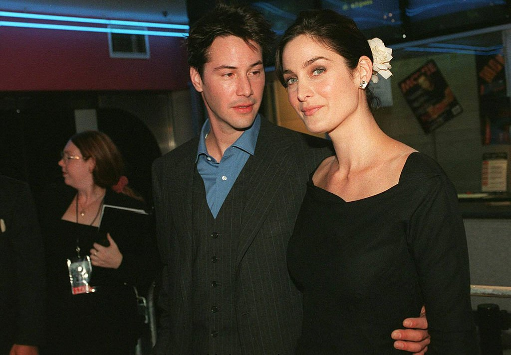 Image Credits: Getty Images / Patrick Riviere | Keanu Reeves and Carrie Anne Moss attend the Australian Premiere of The Matrix in Sydney, Australia.
