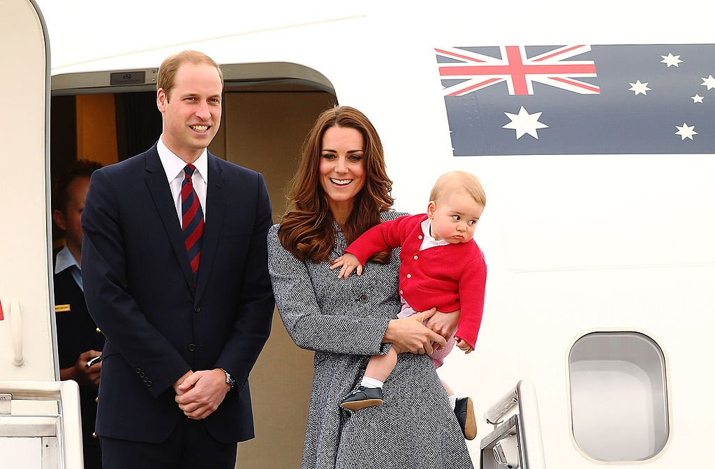 Image Credit: Getty Images / Catherine, Duchess of Cambridge, Prince William, Duke of Cambridge and Prince George of Cambridge after finishing their Royal Visit to Australia on April 25, 2014 in Canberra, Australia.