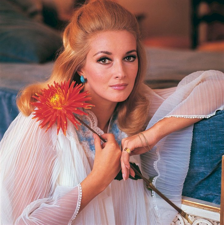 Image Credit: Getty Images / Daniela Bianchi holding a flower.