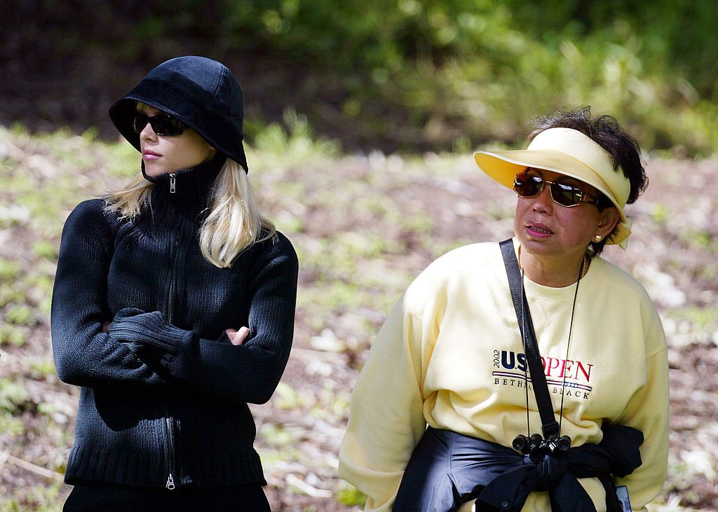 Image Credits: Getty Images / Donald Miralle | Tiger Woods' fiancee Elin Nordegren and his mother Kultida Woods looks on during the 3rd round of the WGC- Accenture Match Play Championship at the La Costa Resort and Spa on February 27, 2004 in Carlsbad, California.