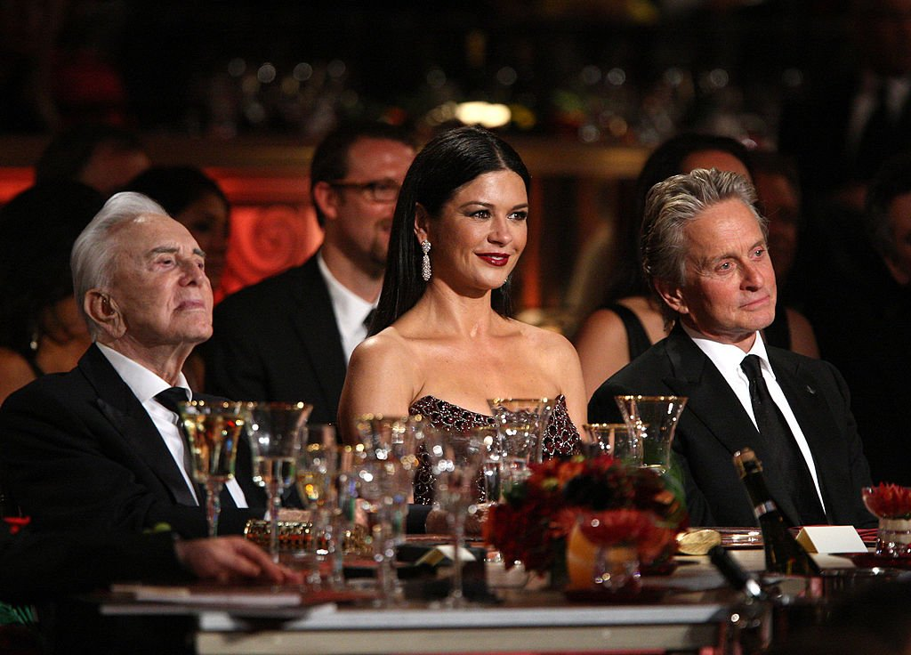 Image Credits: Getty Images / Frazer Harrison | Actors Kirk Douglas, Catherine Zeta-Jones and Michael Douglas in the audience during the AFI Lifetime Achievement Award: A Tribute to Michael Douglas held at Sony Pictures Studios on June 11, 2009 in Culver City, California.