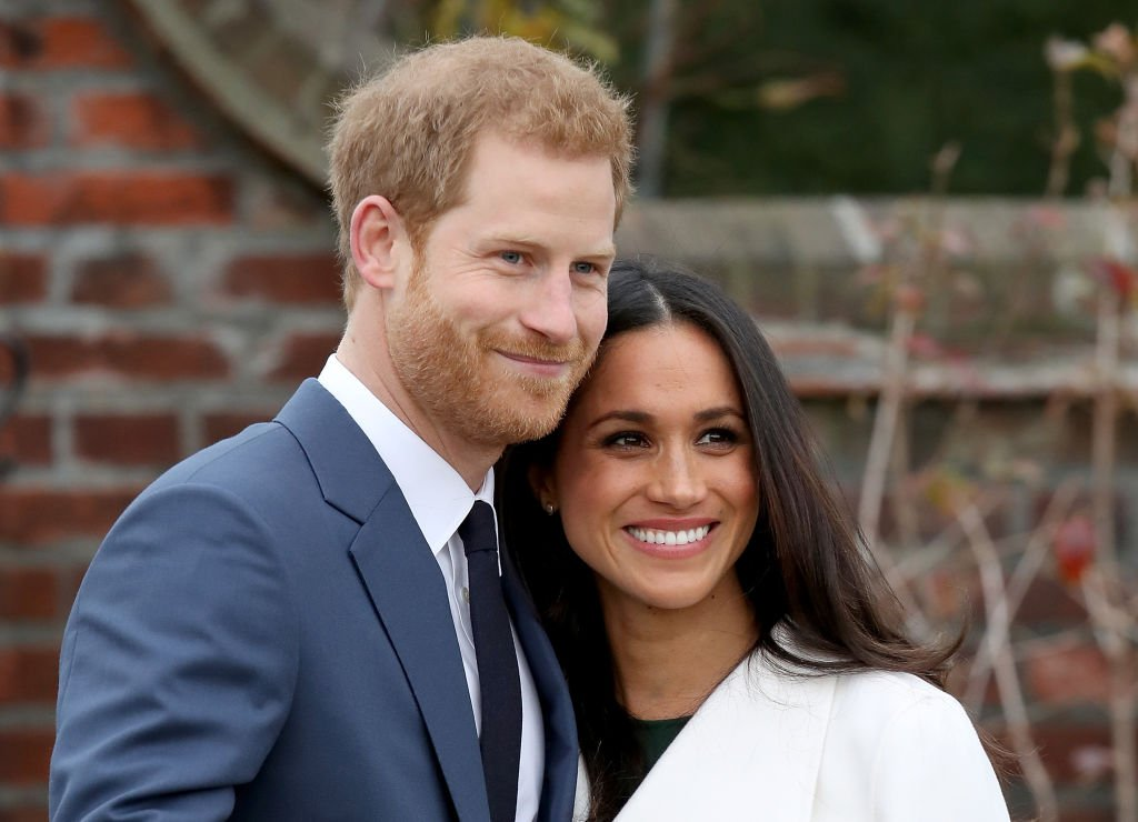 Image Credits: Getty Images / Chris Jackson   Prince Harry and actress Meghan Markle during an official photocall to announce their engagement at The Sunken Gardens at Kensington Palace on November 27, 2017 in London, England. Prince Harry and Meghan Markle have been a couple officially since November 2016 and are due to marry in Spring 2018.
