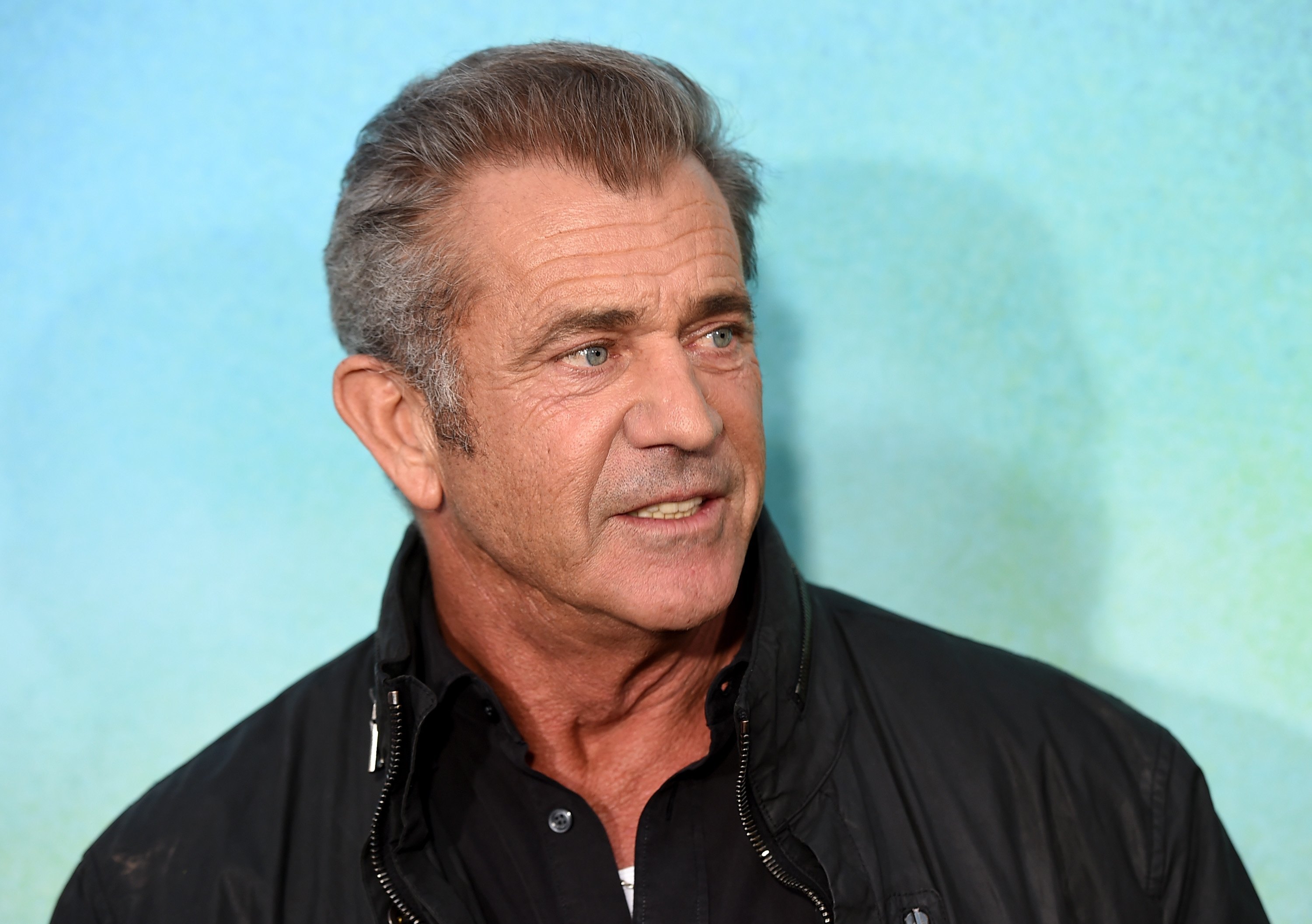 Image Source: Getty Images/Mel Gibson smiling for the camera
