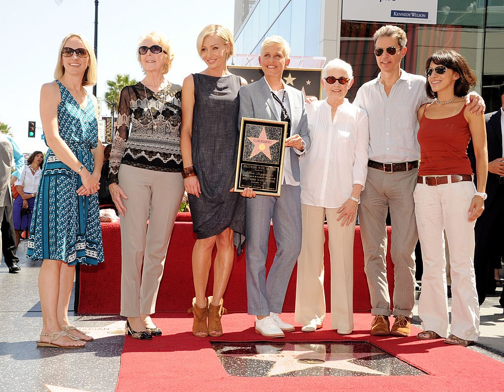 Image Source: Getty Images/Kevin Winter| Comedienne/talk show host Ellen DeGeneres (center), with her family, is honored with a star on the Hollywood Walk of Fame on September 4, 2012 in Los Angeles, California