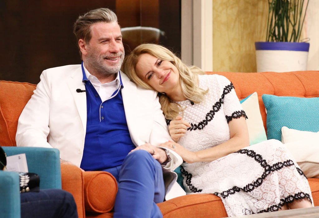 """Image Source: Getty Images/Alexander Tamargo/John Travolta and Kelly Preston are seen on the set of """"Despierta America"""" at Univision Studios to promote the film """"GOTTI"""" on June 8, 2018 in Miami, Florida"""