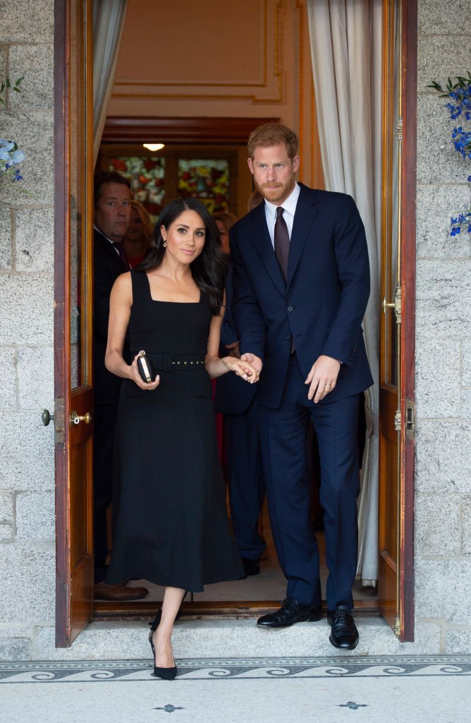 Image Credits: Getty Images / Geoff Pugh - WPA Pool | Prince Harry, Duke of Sussex and Meghan, Duchess of Sussex attend a reception at Glencairn, the residence of Robin Barnett, the British Ambassador to Ireland during day one of their visit to Ireland on July 10, 2018 in Dublin, Ireland.