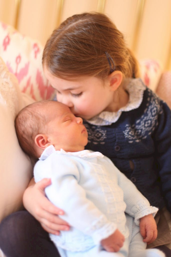 Image Credit: Getty Images / Princess Charlotte of Cambridge kisses her bother, Prince Louis of Cambridge.