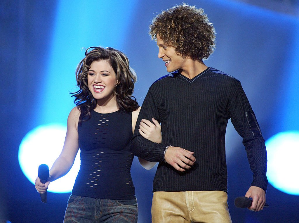 "Image Credit: Getty Images / Kelly Clarkson and Justin Guarini at FOX-TV's ""American Idol"" finale at the Kodak Theatre in Hollywood, Ca. Wednesday, Sept. 4, 2002."