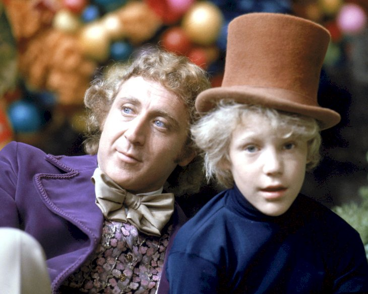 Image Credit: Getty Images/Silver Screen Collection |Gene Wilder as Willy Wonka and Peter Ostrum as Charlie Bucket on the set of the fantasy film 'Willy Wonka & the Chocolate Factory'
