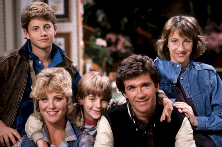 "Image Credits: Getty Images / Walt Disney Television | The cast of the sitcom ""Growing Pains""."