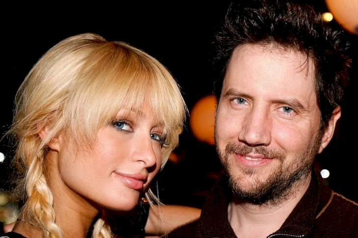Image Credits: Getty Images / Andrew D. Bernstein | Socialite Paris Hilton poses with actor Jamie Kennedy.