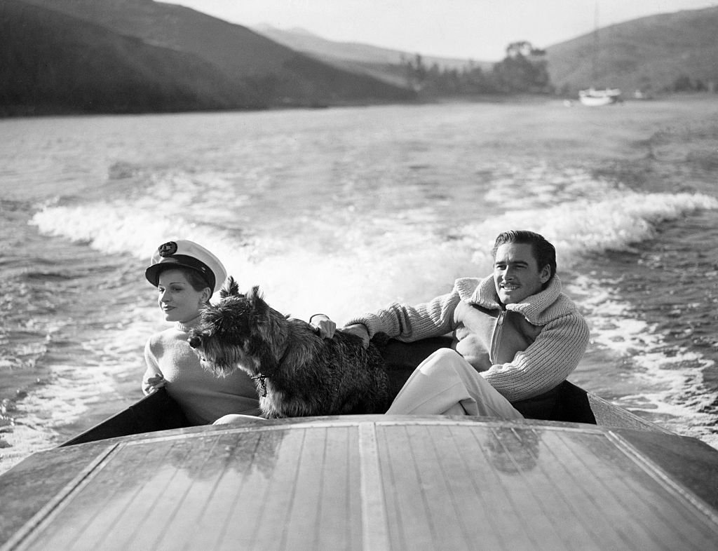 Image Source: Getty Images / Errol Flynn and his first wife, the French film star Lily Damita.