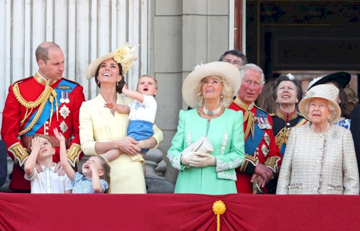 Image Credit: Getty Images / The royal family watch a flypast from the balcony of Buckingham Palace during Trooping The Colour.