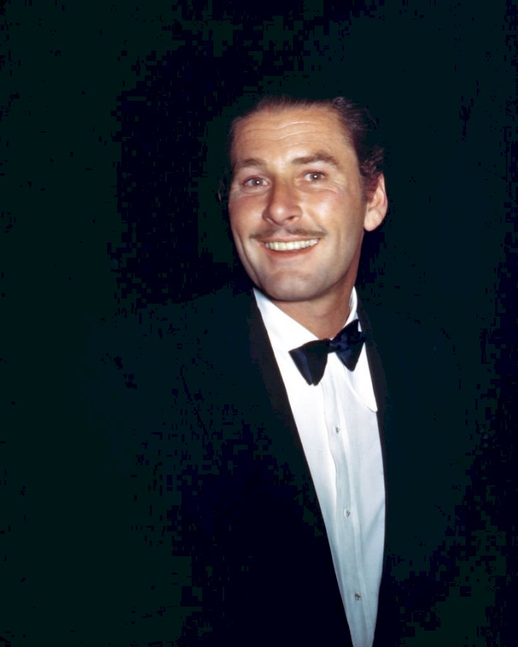 Image Credit: Getty Images // Errol Flynn at an event.