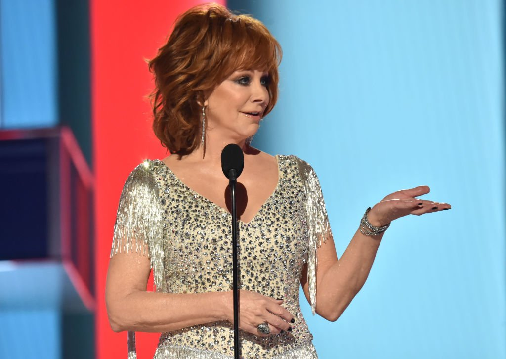 Image Credit: Getty Images / Reba McEntire speaks onstage during the 54th Academy Of Country Music Awards at MGM Grand Garden Arena on April 07, 2019.