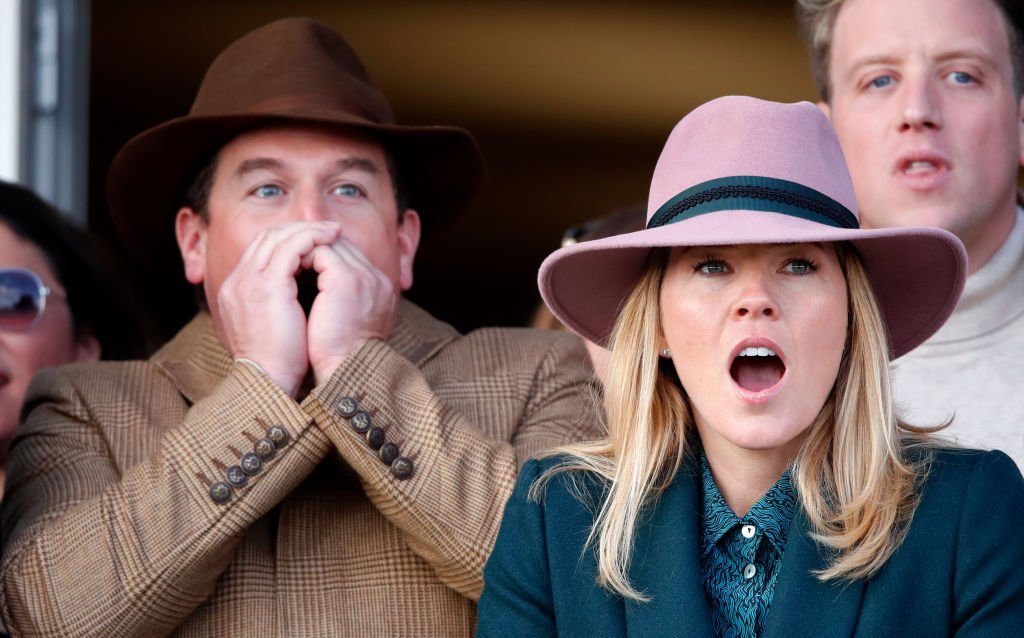 Image Credit: Getty Images / Peter Phillips and Autumn Phillips react as they watch the racing at Cheltenham Racecourse on March 13, 2020 in Cheltenham, England.