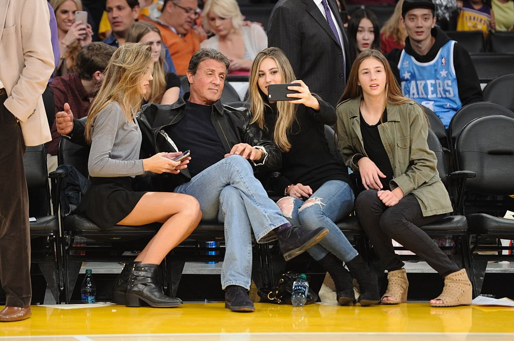 Image Source: Getty Images/GC Images/Noel Vasquez | Stallone and his daughters at a Lakers vs. Rockets game
