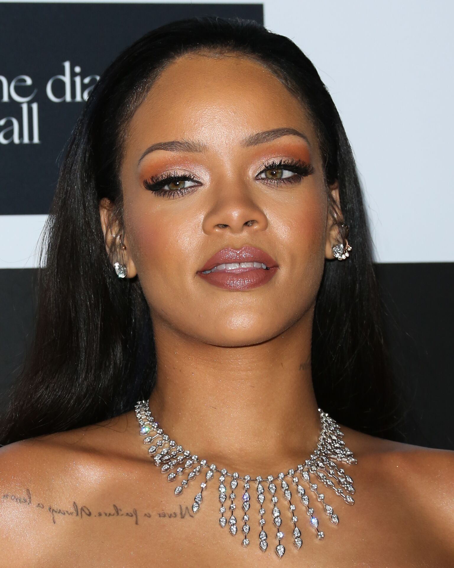 Image Credit: Getty Images / Singer and business mogul, Rihanna poses for a picture on the red carpet.
