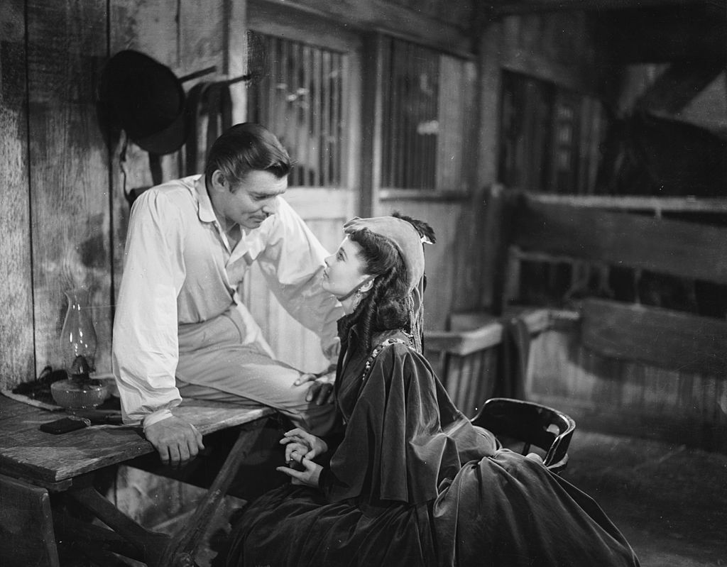 Image Credit: Getty Images / Clark Gable (1901 - 1960) as Rhett Butler with his co-star Vivien Leigh (1913 - 1967) as Scarlett O'Hara in the American civil war epic 'Gone With the Wind'.