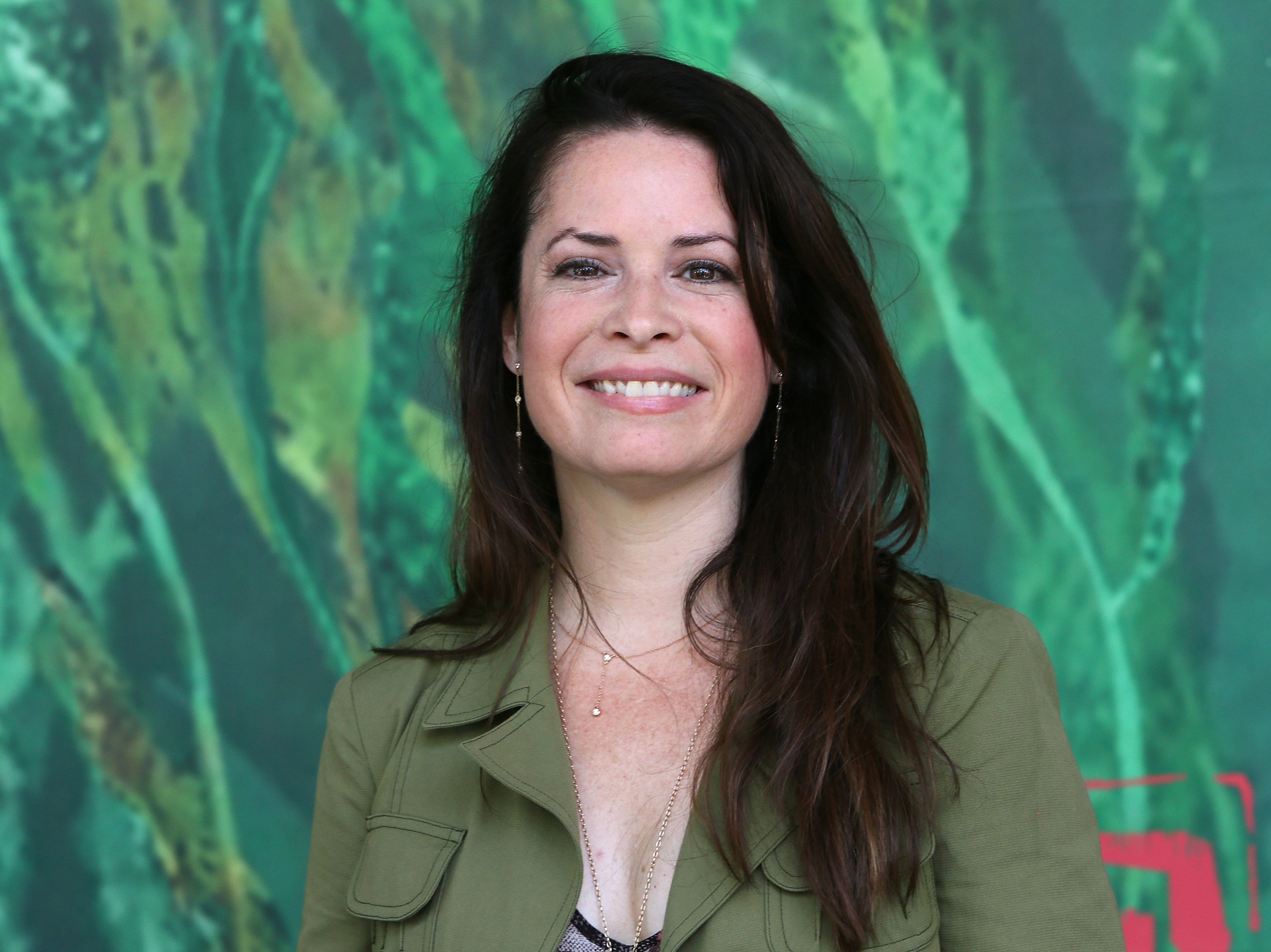 Image Credits: Getty Images   Holly Marie Combs smiling for the camera