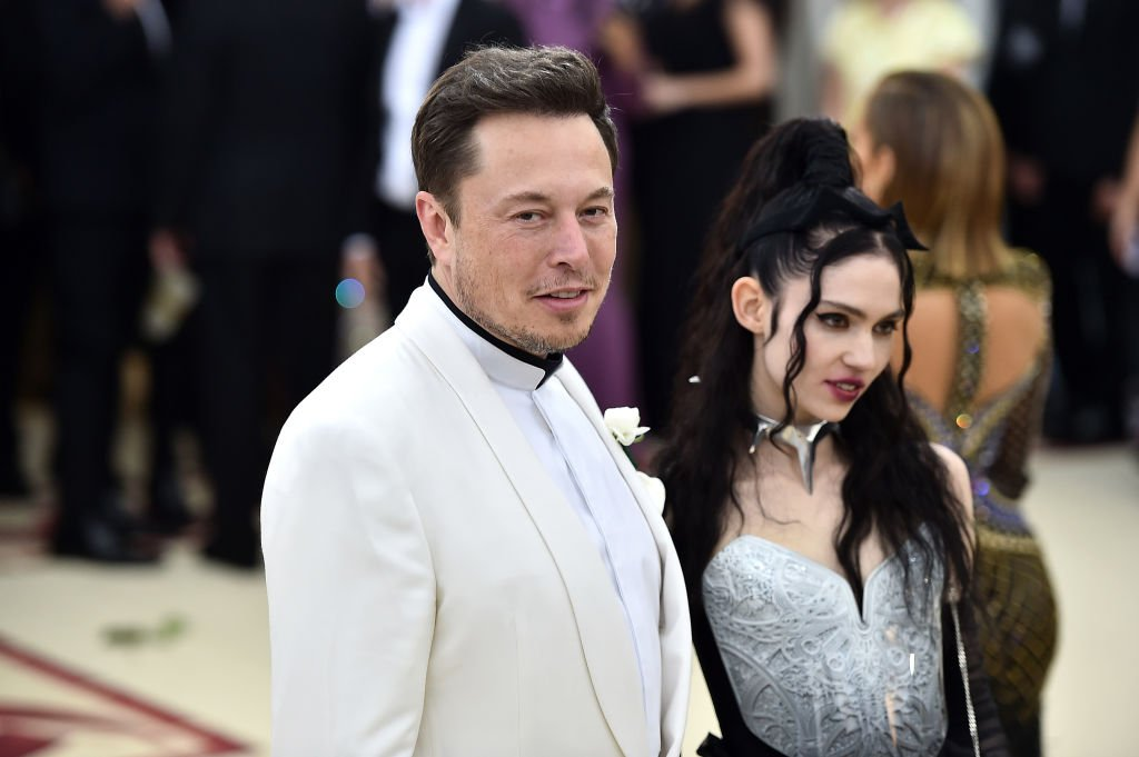 Image Credit: Getty Images / Elon Musk and Grimes attend the Heavenly Bodies: Fashion & The Catholic Imagination Costume Institute Gala at The Metropolitan Museum of Art on May 7, 2018 in New York City.