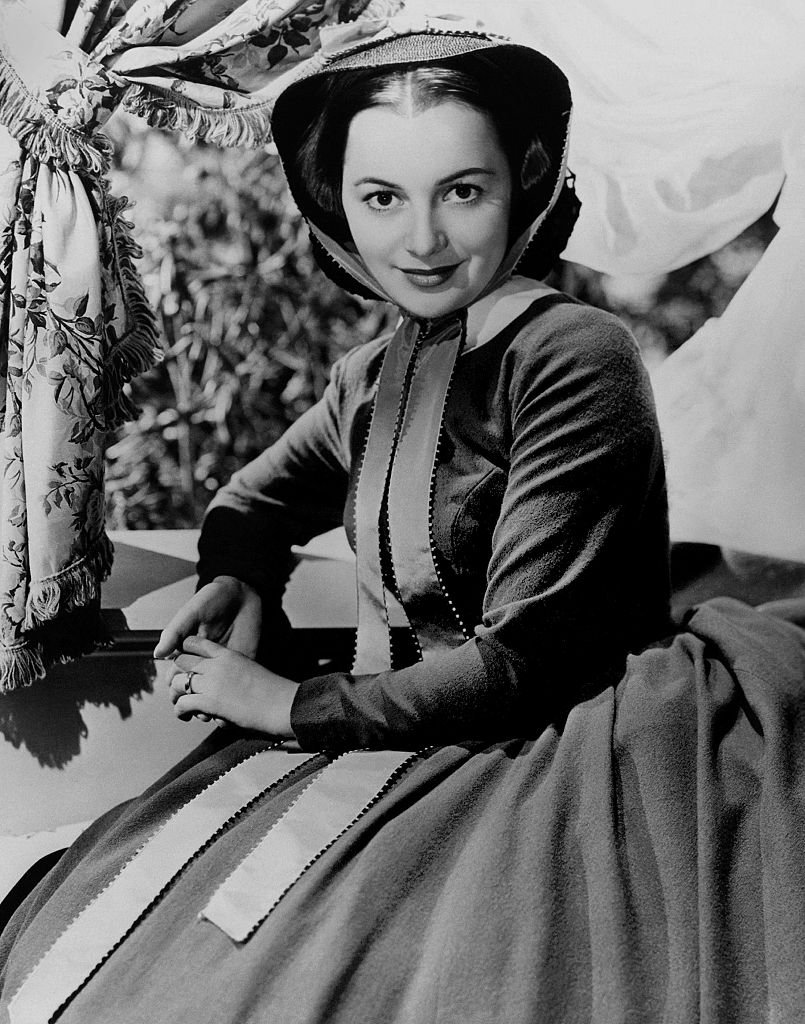 "Image Credits: Getty Images / Donaldson Collection/Michael Ochs Archives | Olivia de Havilland poses for a publicity Still for ""Gone With the Wind"" in 1939"