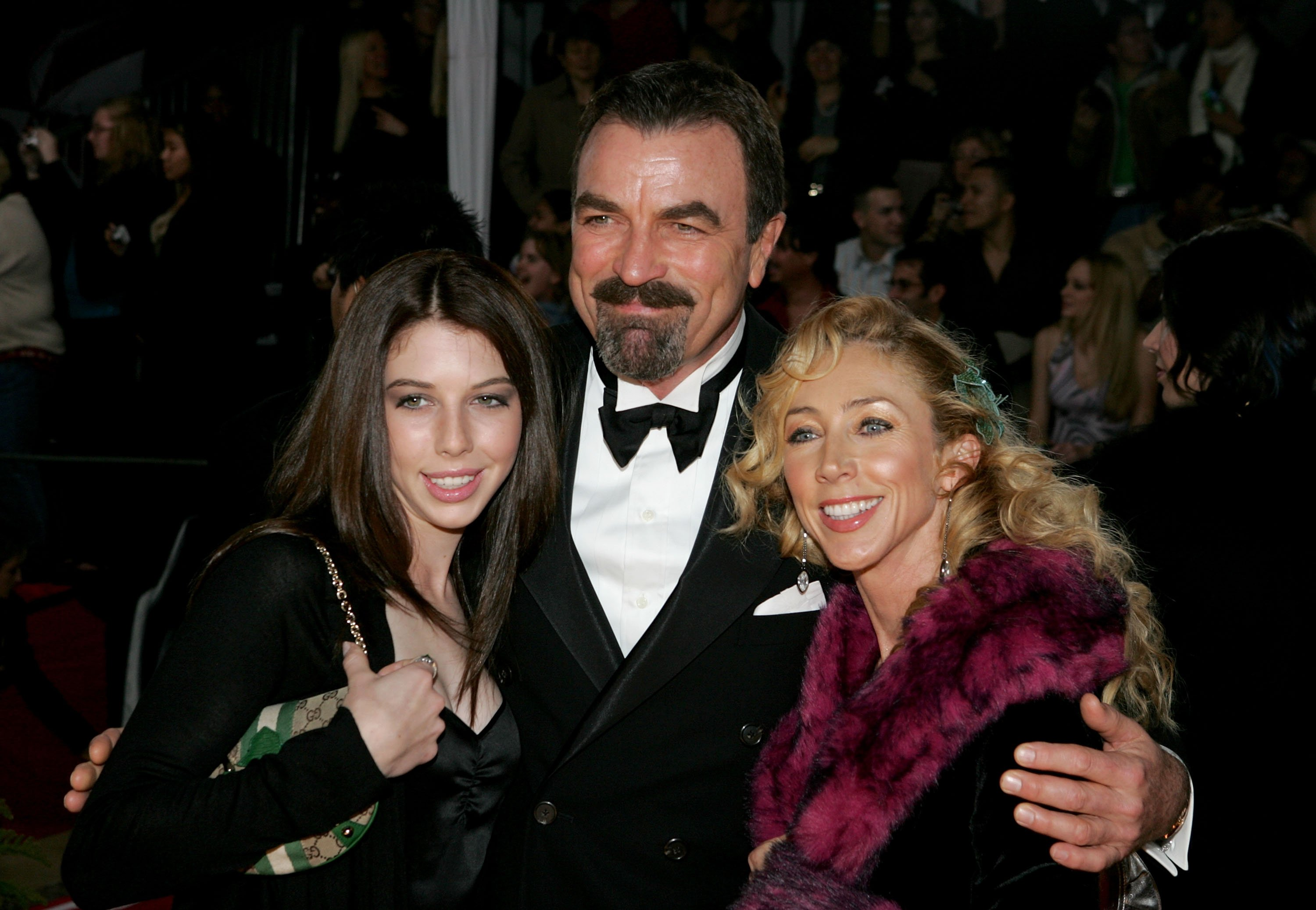 Image Credit: Getty Images/Vince Bucci | Tom Selleck with wife Jillie Mack and daughter Hannah arrive at the 31st Annual People's Choice Awards
