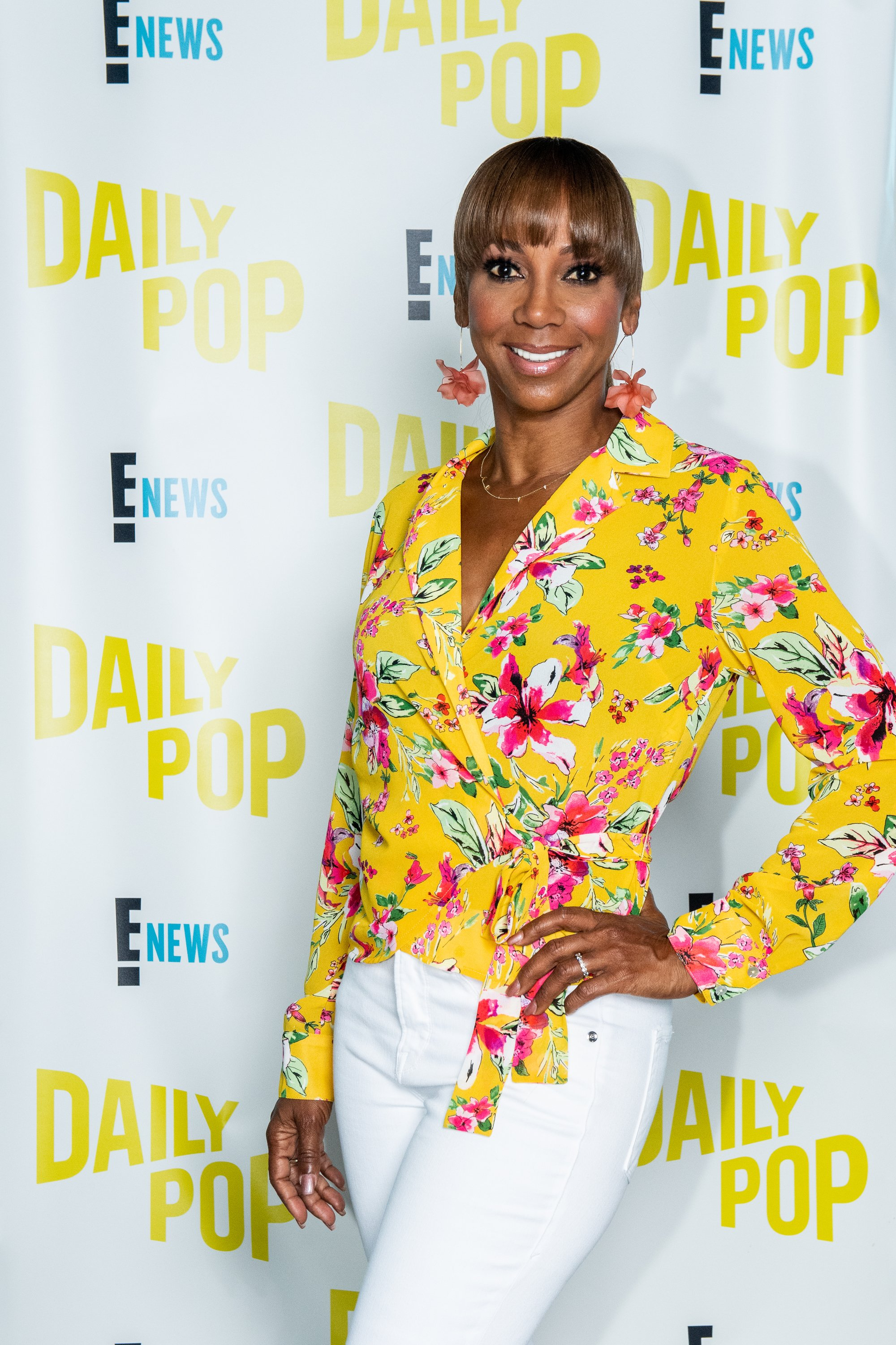 Image Credits: Getty Images / Aaron Poole / E! Entertainment / NBCU Photo Bank / NBCUniversal | Holly Robinson Peete poses for a photo on the set of Daily Pop.