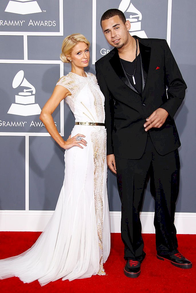 Image Credits: Getty Images / Dan MacMedan / WireImage | Paris Hilton (L) and Afrojack arrive at the 54th Annual GRAMMY Awards held at the Staples Center on February 12, 2012 in Los Angeles, California.
