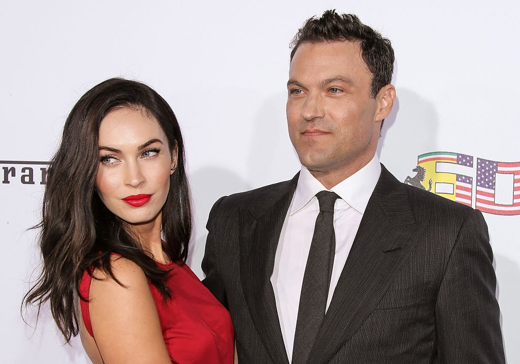 Image Credits: Getty Images / Paul Archuleta / FilmMagic | Actors Megan Fox (L) and Brian Austin Green (R) attend Ferrari's 60th Anniversary In The USA Gala at the Wallis Annenberg Center for the Performing Arts on October 11, 2014 in Beverly Hills, California.